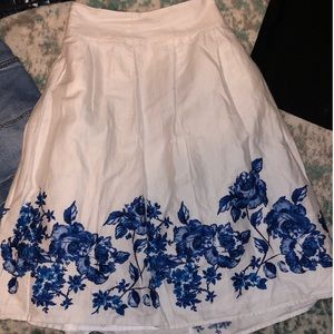 White skirt with blue floral patterns
